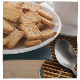 White plate with cookies on the old book napkin
