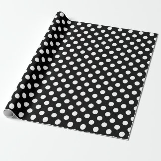 White polka dots on black wrapping paper
