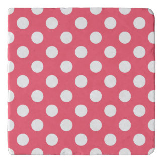 White polka dots on coral trivets