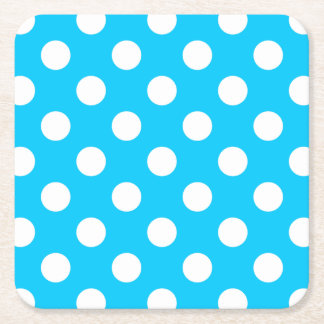 White polka dots on electric blue square paper coaster
