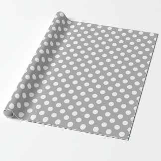 White polka dots on grey wrapping paper