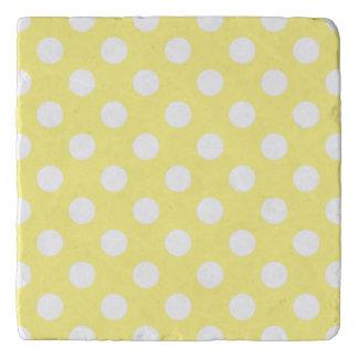 White polka dots on lemon yellow trivet