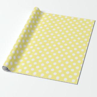 White polka dots on lemon yellow wrapping paper