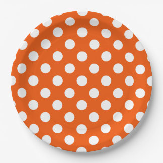 White polka dots on orange 9 inch paper plate