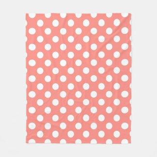 White polka dots on peach fleece blanket