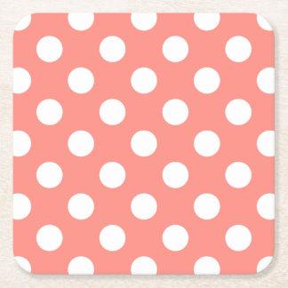 White polka dots on peach square paper coaster