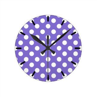 White polka dots on periwinkle wall clocks