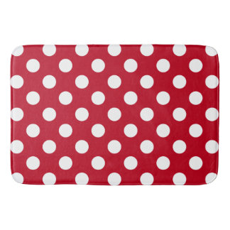 White polka dots on red bath mats