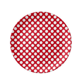 white polka dots on red porcelain plate