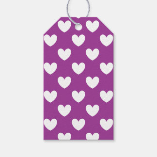 White polka hearts on purple gift tags