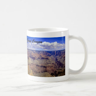 White puffy clouds hanging over the Grand Canyon Coffee Mug