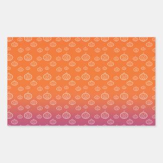White pumpkins on orange purple fade rectangular sticker