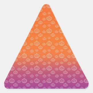 White pumpkins on orange purple fade triangle sticker