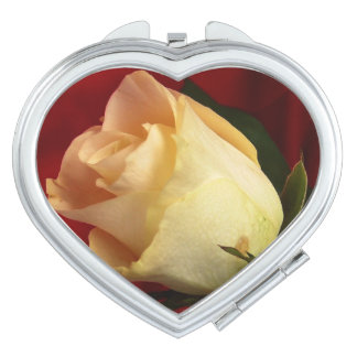 White rose on red background compact mirrors
