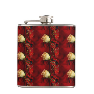 White rose on red background flask