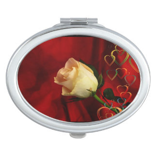 White rose on red background makeup mirrors