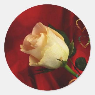 White rose on red background round sticker