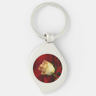 White rose on red background Silver-Colored swirl key ring