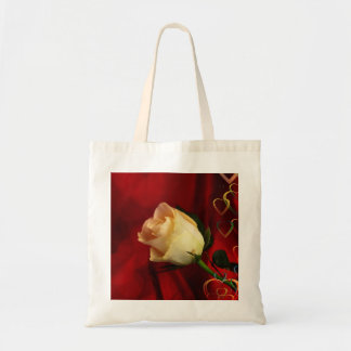 White rose on red background tote bags