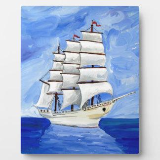 white sailboat on blue sea plaque