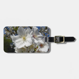 white sakura luggage tag