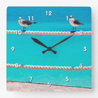 White seagull birds on rope with blue ocean photo square wall clock