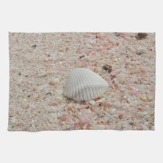 White seashell on Pink Sand Beach Tea Towel