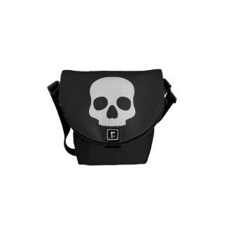White skull on black messenger bag