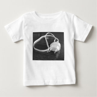 White smartphone charger on wooden table baby T-Shirt