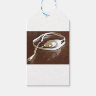 White smartphone charger on wooden table gift tags