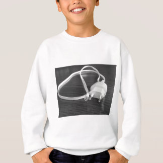 White smartphone charger on wooden table sweatshirt
