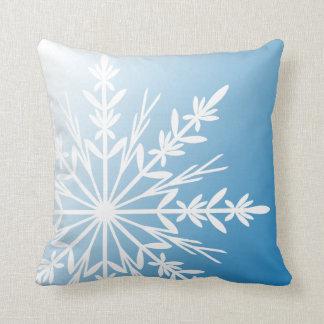 White Snowflake on Blue Cushion