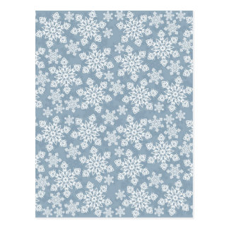 white snowflakes on blue postcard