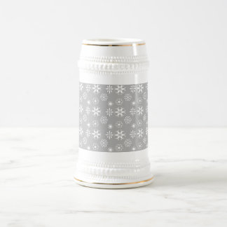 White snowflakes on silver beer steins