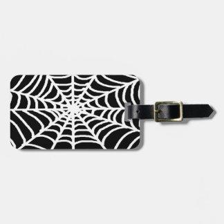 white spider web luggage tag