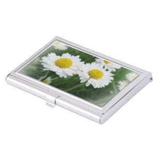 white spring flower in green grass business card holder