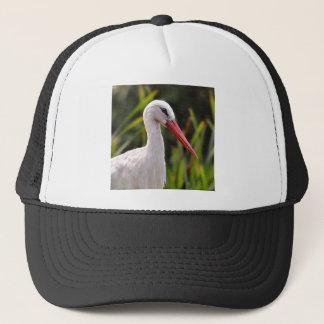 White stork among vegetation trucker hat