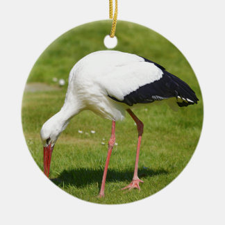 White stork on grass ceramic ornament