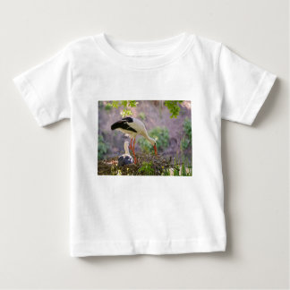 White storks on its nest baby T-Shirt