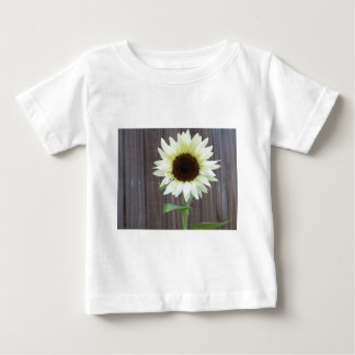 White sunflower against a weathered fence baby T-Shirt