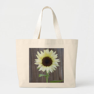 White sunflower against a weathered fence large tote bag