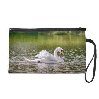 White swan on a lake wristlets