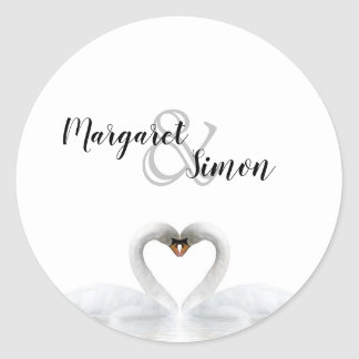 White swans in love with names classic round sticker