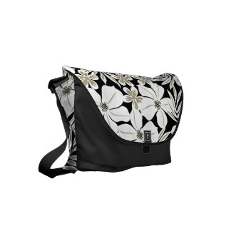 White tropical flowers on black commuter bag