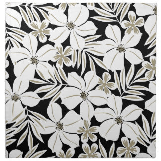 White tropical flowers on black napkin
