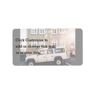 White trunk and house with windows address label