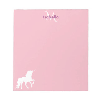 White unicorn on pastel pink monogrammed notepad