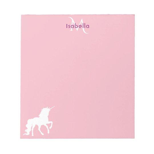 White unicorn on pastel pink monogrammed notepad