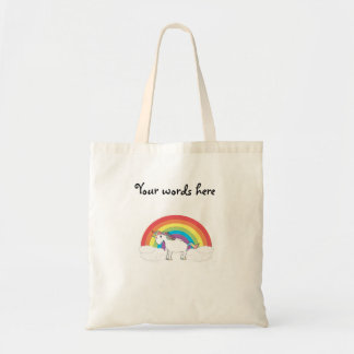 White unicorn on rainbow and clouds tote bags