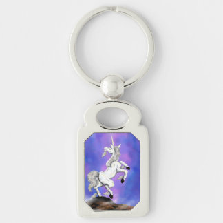 white unicorn standing on a rock Silver-Colored rectangle key ring